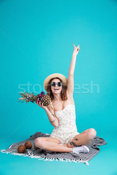 Gülen genç bayan oturma yalıtılmış Stok fotoğraf © deandrobot