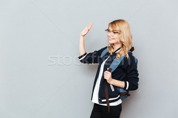 Happy young lady student wearing glasses with backpack Stock photo © deandrobot