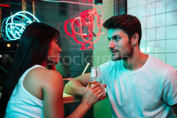 Több nemzetiségű derűs szerető pár iszik sör Stock fotó © deandrobot