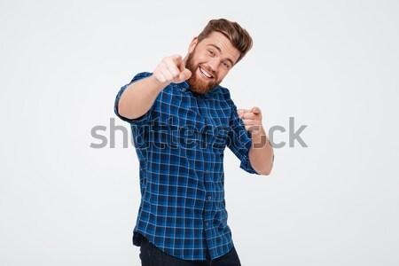 Derűs pozitív férfi mutat kamerába kockás Stock fotó © deandrobot
