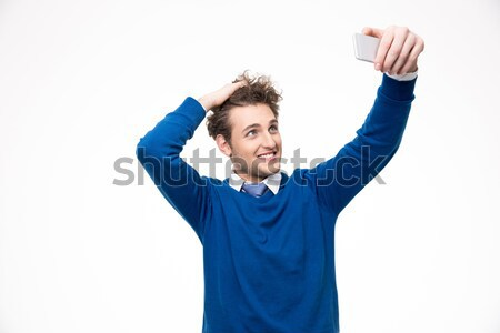 Happy man with fan finger pointing at camera isolated Stock photo © deandrobot