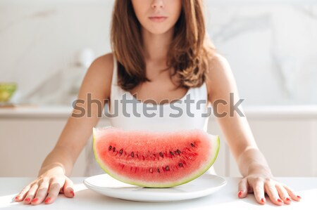 Young woman sitting at the kitchen table Stock photo © deandrobot