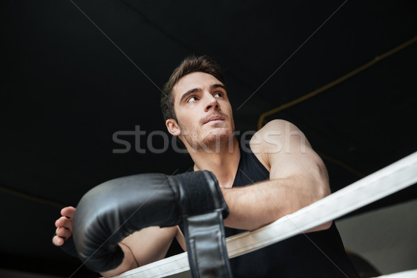Thoughtful sportsman standing on ring Stock photo © deandrobot