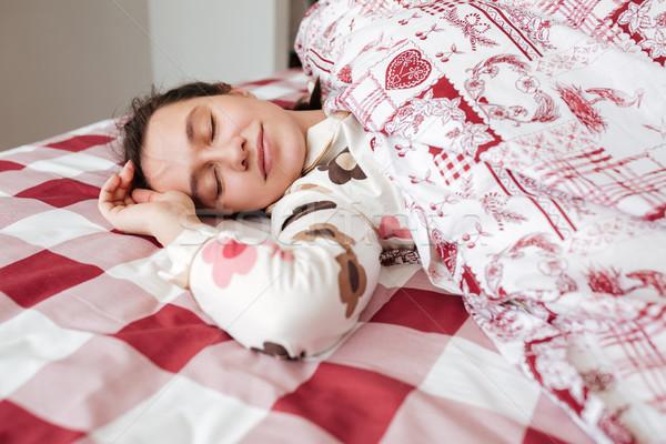 Woman sleeping in bedroom Stock photo © deandrobot