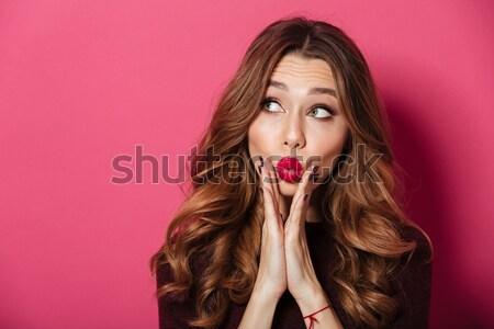 Happy young brunette lady blowing kisses. Stock photo © deandrobot