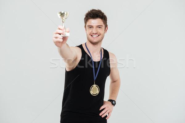 улыбаясь молодые спортсмен вознаграждать фото Сток-фото © deandrobot