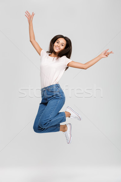 Full length portrait of a happy smiling asian woman Stock photo © deandrobot