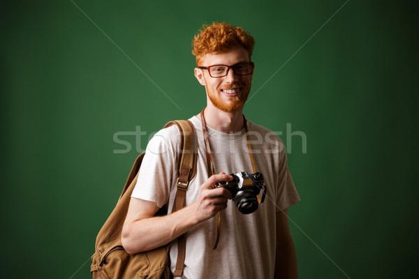 Tiro barbado retro cámara mochila Foto stock © deandrobot