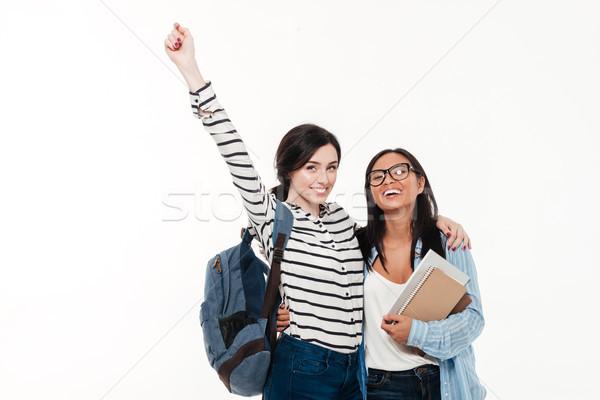 Pár kettő derűs fiatal több nemzetiségű női Stock fotó © deandrobot