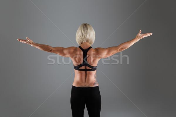 Back view portrait of a muscular adult sportswoman Stock photo © deandrobot