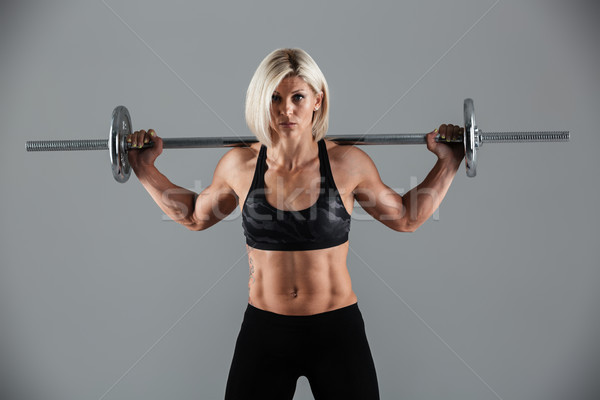 Portrait of a confident muscular adult sportswoman standing Stock photo © deandrobot