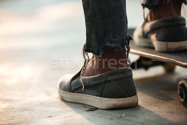 Close up of skateboarders feet standing Stock photo © deandrobot