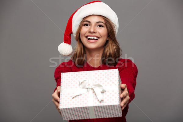 Ritratto sorridere giovane ragazza rosso maglione Foto d'archivio © deandrobot