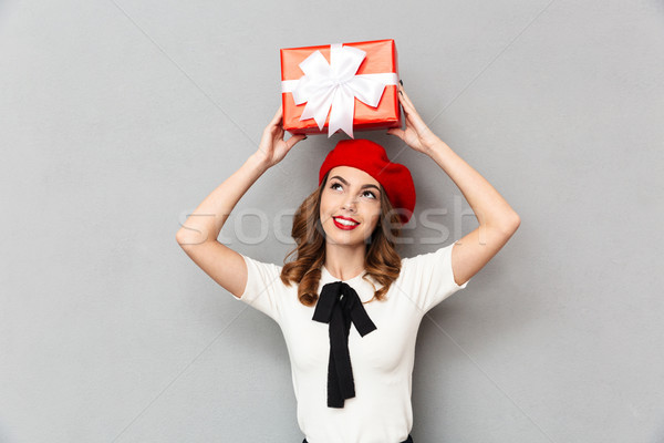 Portrait of a smiling schoolgirl dressed in uniform Stock photo © deandrobot