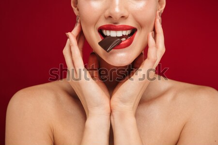 Close up portrait of a happy brown haired woman Stock photo © deandrobot