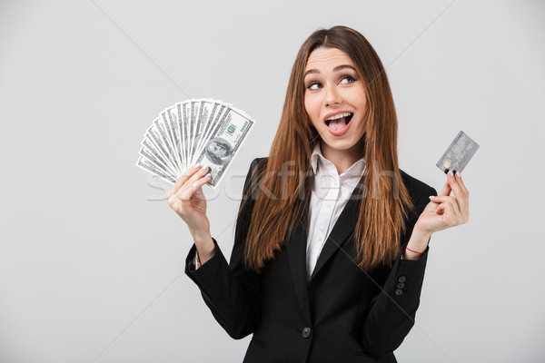 Portrait of a satisfied businesswoman dressed in suit Stock photo © deandrobot
