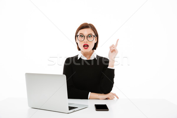 Business lady wearing glasses have an idea. Stock photo © deandrobot