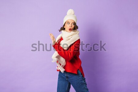 Portrait of a happy girl dressed in hat and scarf Stock photo © deandrobot