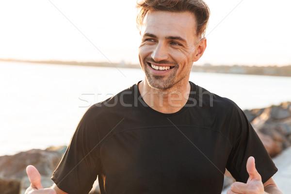 Portré mosolyog sportoló ünnepel siker kint Stock fotó © deandrobot