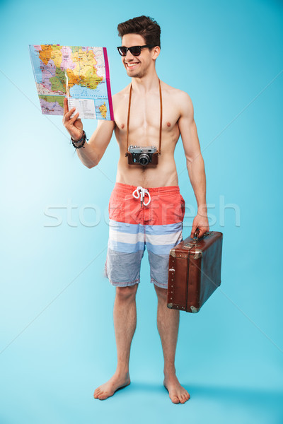 Teljes alakos portré derűs fiatal póló nélkül férfi Stock fotó © deandrobot