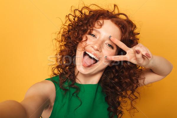 Close up portrait of a joyful redhead woman in dress Stock photo © deandrobot
