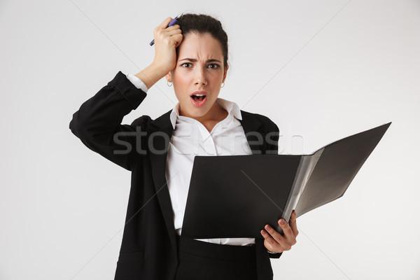 Nervioso confundirse jóvenes mujer de negocios carpeta Foto stock © deandrobot