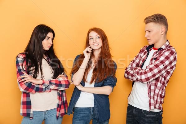 Groep verward school vrienden naar ander Stockfoto © deandrobot
