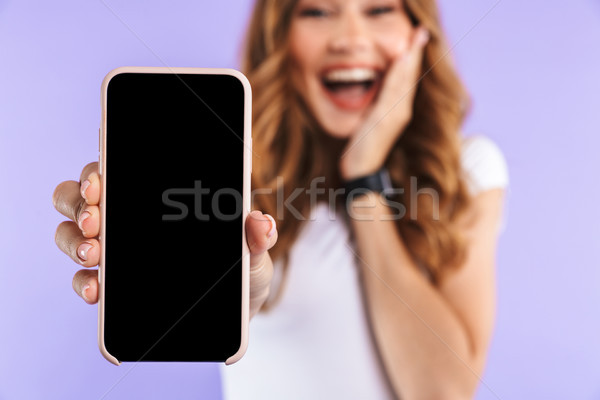 Close up of an excited young girl standing Stock photo © deandrobot