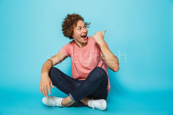Portrait jeunes homme pointant Photo stock © deandrobot