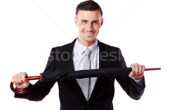 Portrait of a businessman holding umbrella isolated on a white background Stock photo © deandrobot