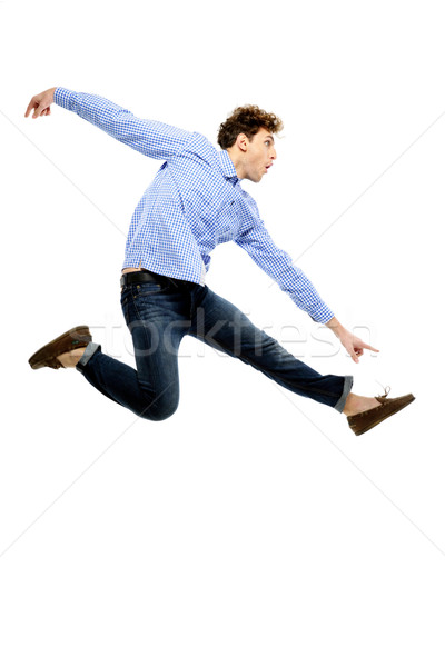 Funny man flying over white background Stock photo © deandrobot