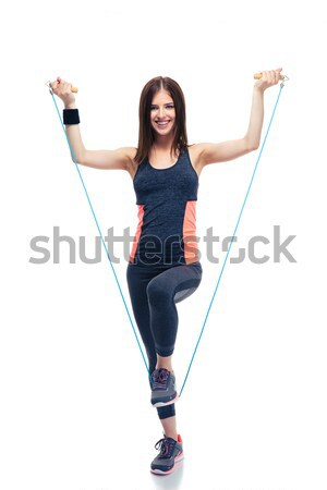 Happy woman standing with jumping rope Stock photo © deandrobot