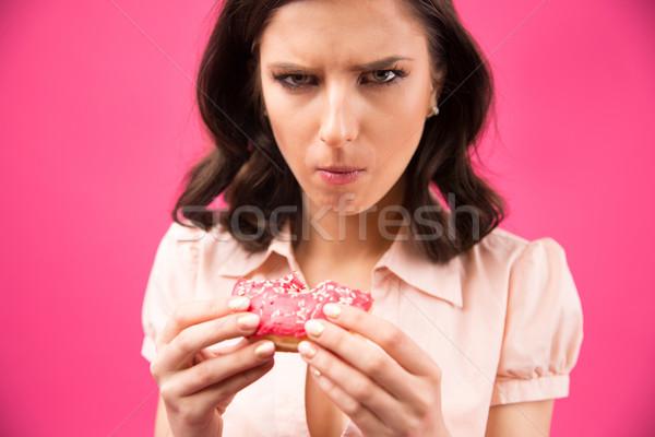 ストックフォト: 若い女性 · 食べ · ドーナツ · ピンク · 女性 · 少女