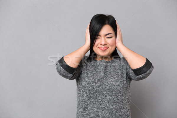 Woman covering her ears  Stock photo © deandrobot