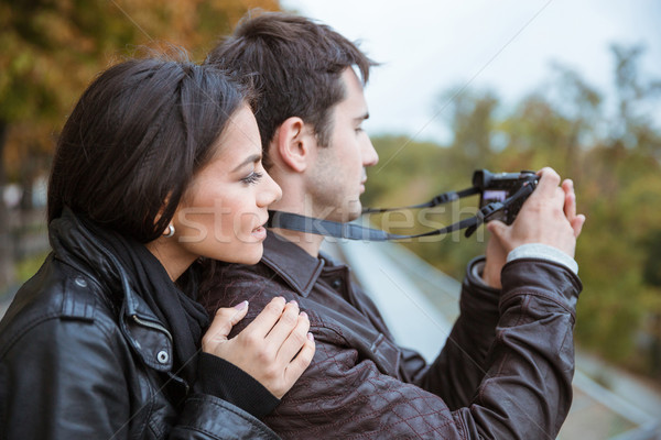 Couple traveling and making photo on camera Stock photo © deandrobot