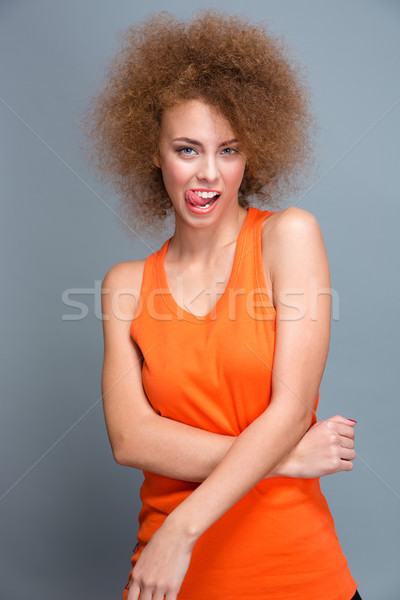 Curly seductive flirty girl showing tongue Stock photo © deandrobot