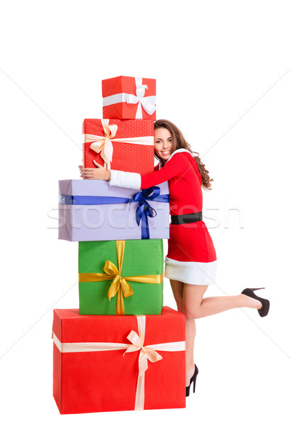 Happy woman in santa claus cloth hugging many gift boxes Stock photo © deandrobot