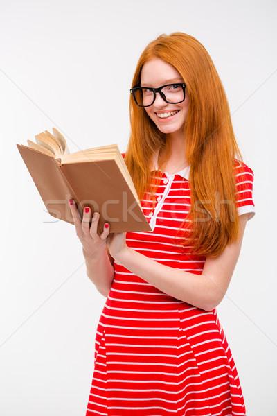 Lächelnd Rotschopf Mädchen Gläser Lesung Buch Stock foto © deandrobot