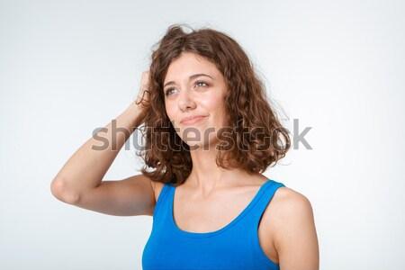 Pensive woman looking away Stock photo © deandrobot