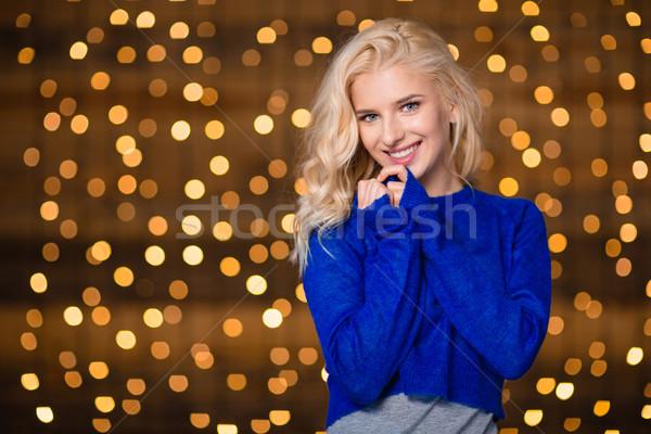 Bonitinho mulher em pé férias luzes retrato Foto stock © deandrobot