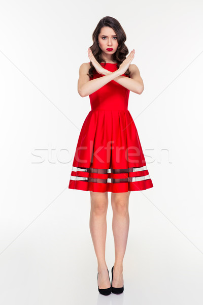 Woman showing stop sign with crossed hands Stock photo © deandrobot