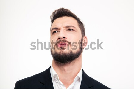 Portrait of pensive attractive young man thinking and looking up Stock photo © deandrobot