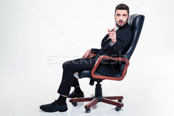 красивый деловой человек офисные кресла указывая молодые Сток-фото © deandrobot