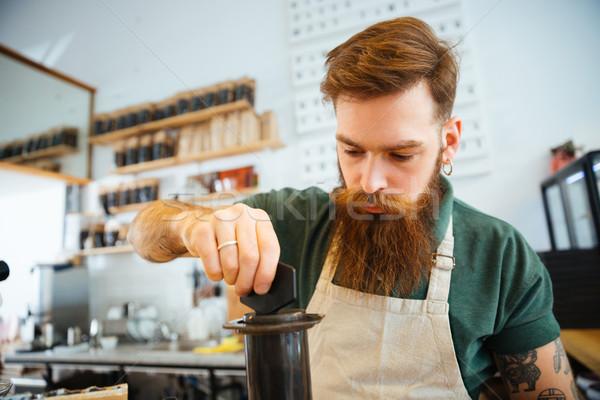 Barista preparing coffee Stock photo © deandrobot