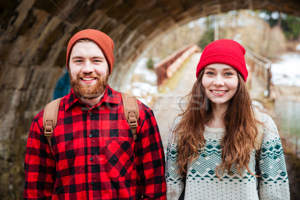 Portrait of happy couple standing outdoors in winter Stock photo © deandrobot