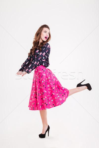 Meglepett aranyos játékos fiatal nő fekete magassarkú Stock fotó © deandrobot