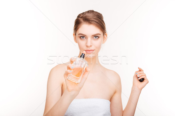 Beautiful young woman with bottle of parfum Stock photo © deandrobot