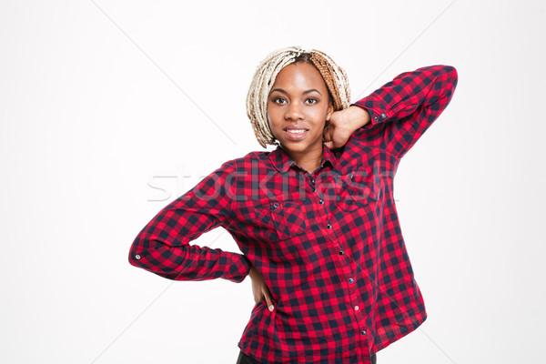 Heureux femme à carreaux shirt séduisant Photo stock © deandrobot
