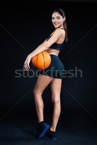 Beautiful fitness woman holding basketball ball Stock photo © deandrobot