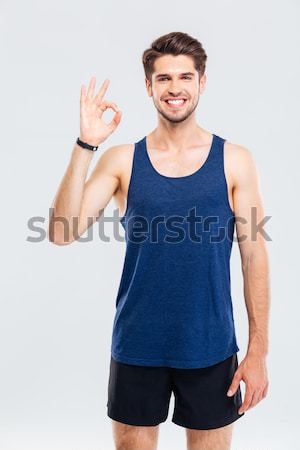 Close-up portrait of a fitness man showing okay sign Stock photo © deandrobot